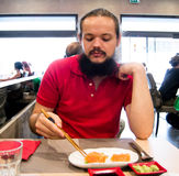 Man eating his meal at a Japanese restaurant Royalty Free Stock Photo