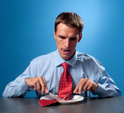 Man eating his tie Stock Photo