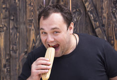 Man eating a hot dog. Brutal man eating a hot dog Royalty Free Stock Image