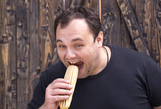 Man eating a hot dog. Brutal man eating a hot dog Royalty Free Stock Photography