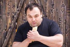 Man eating a hot dog Royalty Free Stock Image