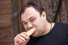 Man eating a hot dog. Brutal man eating a hot dog Stock Photography