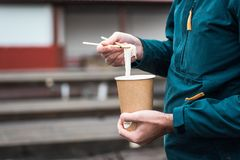 Man Eating Hot Vietnamese Food In A Biodegradable Cup Royalty Free Stock Photography