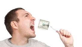 Man eating hundred dollar bill Royalty Free Stock Photo