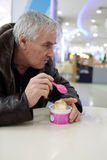 Man eating ice cream Royalty Free Stock Photo