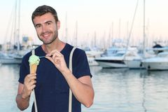 Man eating an ice cream with a spoon Stock Photography