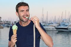 Man eating an icecream with a spoon Stock Photography