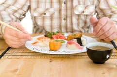 Man Eating an  Japanese Food . Royalty Free Stock Image