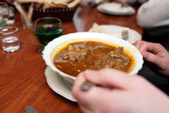 Man eating kharcho Stock Photo