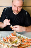 Man eating king crab Royalty Free Stock Image