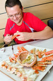 Man eating King crab Stock Photos