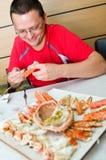 Man eating King crab stock photos