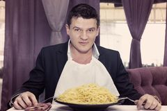 Man eating a large portion of pasta Stock Image