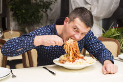 Man eating a large portion of pasta Stock Photography