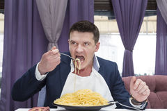 Man eating a large portion of pasta Stock Photos