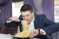 Man eating a large portion of pasta Stock Images