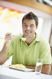 Man Eating Lunch At A Cafe Royalty Free Stock Photography