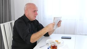 Man Eating Lunch Read Newspaper Bad News and Gesticulate Nervous and Irritated.  stock footage