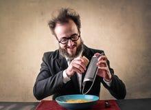 Man eating macaroni Royalty Free Stock Images