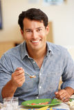 Man eating meal Stock Images