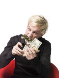 Man eating money. Towards white background Stock Photo