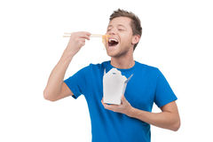 Man eating noodles. Stock Image