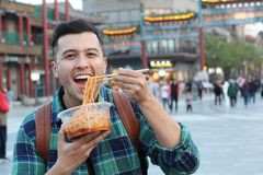 Man eating noodles outdoors in Asia royalty free stock photography