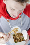 Man eating noodles Stock Images