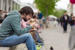 Man eating outdoors on food festival in Ljubljana, Slovenia. Royalty Free Stock Photography