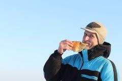 The man  eating pancake Royalty Free Stock Photos