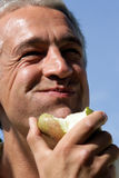 Man eating pear Stock Photography