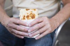 Man eating piadina or wrap royalty free stock photos