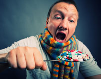 Man eating pills Royalty Free Stock Image