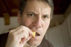 Man eating pineapple Royalty Free Stock Image