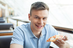 Man eating pizza. Royalty Free Stock Photography