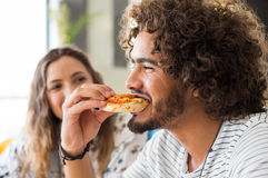 Man eating pizza Royalty Free Stock Photography