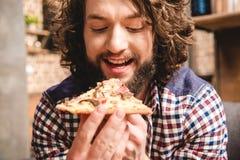 Man eating pizza Stock Photo