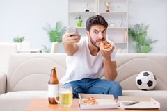 The man eating pizza having a takeaway at home relaxing resting Stock Photography