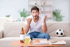 The man eating pizza having a takeaway at home relaxing resting Royalty Free Stock Images