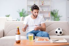 The man eating pizza having a takeaway at home relaxing resting Stock Photo