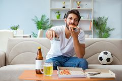 The man eating pizza having a takeaway at home relaxing resting Royalty Free Stock Image