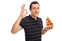 Man eating pizza and making an ok gesture. Joyful young man eating a slice of pizza and making an ok gesture with his hand isolated on white background Stock Images