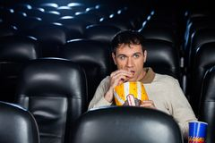 Man Eating Popcorn While Watching Movie In Theater Royalty Free Stock Photo