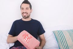 Man eating popcorn and watching movies. Royalty Free Stock Images
