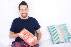 Man eating popcorn and watching movies. Stock Photography