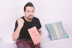 Man eating popcorn and watching movies. Royalty Free Stock Photography