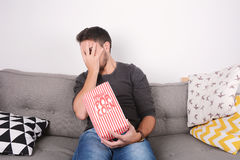 Man eating popcorn and watching movies. Royalty Free Stock Image