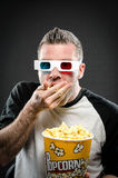 Man eating popcorn wearing 3d glasses Stock Photos