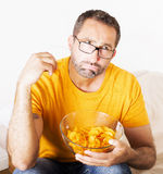 Man eating potato chips Stock Photography