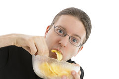 Man eating potato chips hurriedly Royalty Free Stock Photography